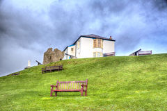 Ruins and cannon on Tenby hill Pembrokeshire Wales UK Stock Images