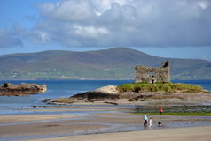 Ruins of castle on the beach. Ireland Royalty Free Stock Image