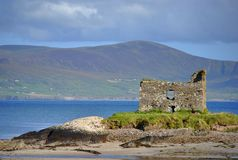 Ruins of castle on the beach. Ireland Royalty Free Stock Photos