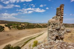 Ruins of castle and drought with dry dam Royalty Free Stock Photo