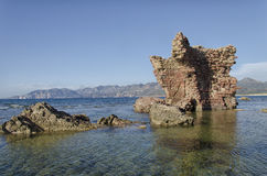 Ruins of castle emerges from the sea Royalty Free Stock Photos