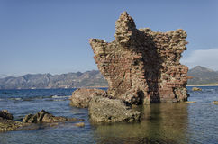Ruins of a castle emerges from the sea Royalty Free Stock Image