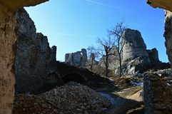 Ruins of castle Gymes, Slovakia, view from St. Ignatius church remains on southeastern palace and half circle residental tower Stock Photos