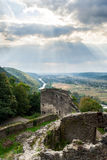 Ruins of castle in mountain. View to village in vally from stone wall of an old ruined castle in the mountains Stock Photography
