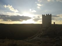 Ruins of a castle overlooking a field royalty free stock photos