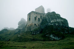 Ruins of castle. On rocks stock photography
