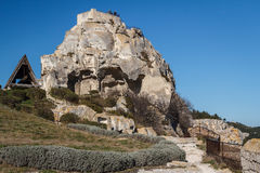 Ruins of the castle standing atop of picturesque village Royalty Free Stock Photography