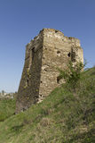 Ruins of the castle tower. On the bank of the river, western Ukraine Stock Photos
