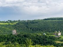The ruins of the castle and the village on the hill. Ruins of the Chervonohorod Castle on a hill. Architect Julian Oktawian Zachariewicz-Lwigród. Building of stock images