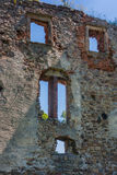 The ruins of the castle walls. Wall with openings for windows through which you can see the sky. The residue from the castle. The ruins. Country: Poland Stock Images