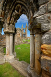 Ruins of the cathedral of Saint Andrews. This picture shows the cemetery of Saint Andrews in Scotland. The cemetery is located at the site of the ruins of the Royalty Free Stock Photo