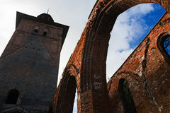 The ruins of the Catholic Cathedral inside view. The historical building built of a red brick from the remains of arch apertures and a bell tower. Before Stock Photos