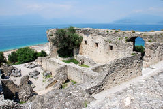 Ruins of Catull Grottos. Part of the ruins of Catull Grottos, built on the peninsula of Sirmione, Lake Garda, Italy Stock Image