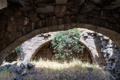 Ruins of a Christian monastery of the 6th century AD in the abandoned village of Deir Qeruh in the Golan  Heights, Israel. Ruins of a Christian monastery of the Stock Photo