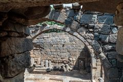Ruins of a Christian monastery of the 6th century AD in the abandoned village of Deir Qeruh in the Golan  Heights, Israel. Ruins of a Christian monastery of the Royalty Free Stock Photography