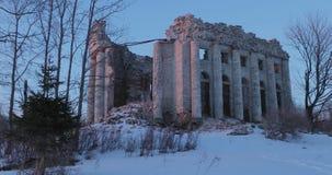 Ruins Church of the Holy Trinity in the village of Pyataya Gora, Volosovsky district, Leningrad region. Winter video at. Sunset stock footage