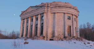 Ruins Church of the Holy Trinity in the village of Pyataya Gora, Volosovsky district, Leningrad region. Winter video at. Sunset stock video