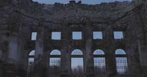 Ruins Church of the Holy Trinity in the village of Pyataya Gora, Volosovsky district, Leningrad region. Winter video at. Sunset stock video footage
