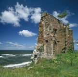 Ruins of church on the see coast. Poland. Baltic Sea. Trzesacz village. Ruins of Gothic church (only fragment of southern wall) from XIV/XV-th century destroyed Stock Photos