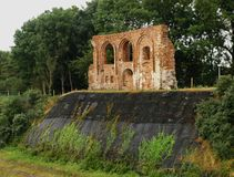 The ruins of the church. The ruins of a Gothic church of the fifteenth century on the escarpment in Trzęsaczu.Świątynia was Spyridon by the tides of the Royalty Free Stock Photography
