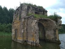 Ruins of the church in the water royalty free stock photography