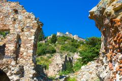 Ruins and churches of the medieval Byzantine ghost town-castle of Mystras, Peloponnese. Ruins and churches of the medieval Byzantine ghost town-castle of royalty free stock image