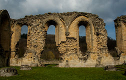Ruins of Cistercian abbey. Ancient stone ruins of a Medieval Cistercian Abbey Stock Photos