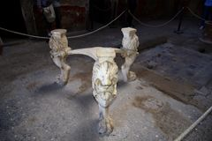 Lion table legs in the once buried Roman city of Pompeii south of Naples under the shadow of Mount Vesuvius. Ruins in the city of Pompeii Italy visited by stock image