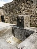 Water basin in the Street in the once buried Roman city of Pompeii south of Naples under the shadow of Mount Vesuvius Stock Image