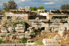 Ruins in Corinth, Greece - archaeology background. Ancient Korynthos, Greece. Ruins in Corinth, Greece - archaeology background Royalty Free Stock Images