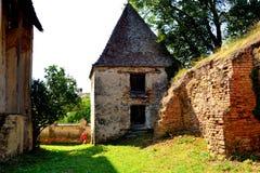 Ruins. Courtyard of the fortified medieval saxon evangelic church in the village Felmer, Felmern, Transylvania, Romania. Stock Photos