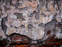 Ruins with cracked plaster on old brick wall. royalty free stock photo