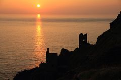 Crown Mines, Botallack at Sunset. The ruins of the Crown Mines, Botallack, Cornwall, UK. Maintained by the National Trust and made popular in recent times by Stock Image