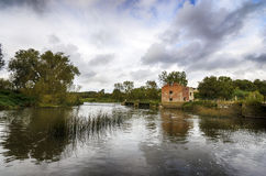 Cutt Watermill. The ruins of Cutt Mill on the banks of the river Stour at Hinton St Mary, near Sturminster Newton in Dorset Stock Images