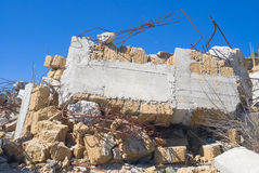Ruins of desolate home against blue sky. Royalty Free Stock Image