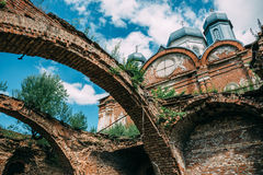 Ruins of destroyed and demolished abandoned Orthodox church or temple. Toned Stock Image