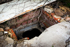 Ruins of destroyed house. Abandoned earthen cellar. royalty free stock photos