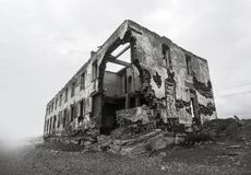 Ruins of the destroyed house. Hot spots on the planet Stock Photo