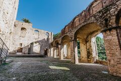 Ruins of the Doria Castle in Dolceacqua, arches and walls, daytime, Italy