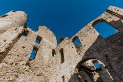 Ruins of the Doria Castle in Dolceacqua, arches, windows and walls, daytime, Italy