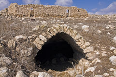 Ruins in a dry field. Cave and a house ruins in the middle of a dry rocky field - Israel Royalty Free Stock Photo