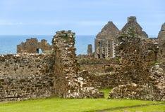Ruins of Dunluce Castle in Northern Ireland. Northern Ireland: Ruins of Dunluce Castle built on the dramatic coastal cliffs of the Atlantic Ocean coastline Stock Photos