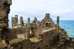 Ruins of Dunluce Castle in Northern Ireland. Northern Ireland: Ruins of Dunluce Castle built on the dramatic coastal cliffs of the Atlantic Ocean coastline Royalty Free Stock Photography