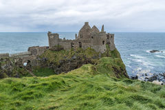 Ruins of Dunluce Castle in Northern Ireland. Dunluce Castle is a now-ruined medieval castle in Northern Ireland. It is located on the edge of a basalt royalty free stock images
