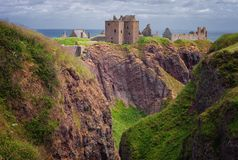 Ruins of Dunottar castle on a cliff, on the north east coast of royalty free stock image