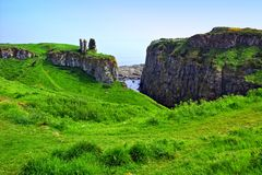 Ruins of Dunseverick Castle along cliffs of the Causeway Coast, Northern Ireland stock images