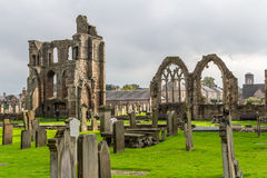 Ruins of Elgin cathedral in northern Scotland. Elgin, Scotland - September 18, 2014: Landscaped view of ruinous Elgin cathedral , with prominent gothic windows Stock Photo