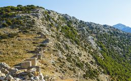 Ruins of encient windmills built in 15th century. Lassithi Plateau, Crete, Greece. Most typical characteristic of the stock photo