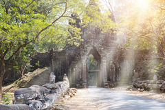 Ruins of entrance gate of the temple 12th century, Siem Reap,  Cambodia north gate Angkor Thom Royalty Free Stock Photo