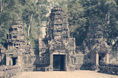 Ruins of entrance gate of the temple 12th century, Siem Reap,  Cambodia north gate Angkor Thom, toning Stock Images